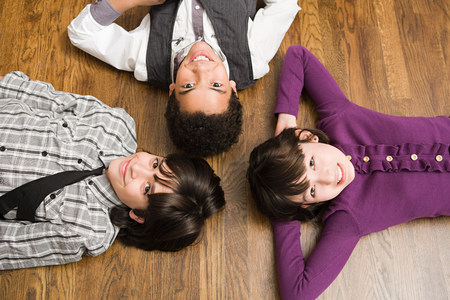 looking at viewer: Children lying on floor
