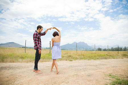 Couple dancing in a field LANG_EVOIMAGES