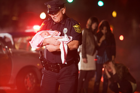 Police officer rescuing a baby LANG_EVOIMAGES