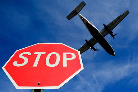 Airplane and stop sign LANG_EVOIMAGES