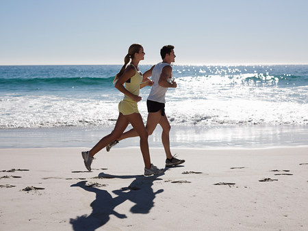 Young couple jogging on beach LANG_EVOIMAGES