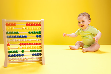 cheer full: Baby boy playing with abacus