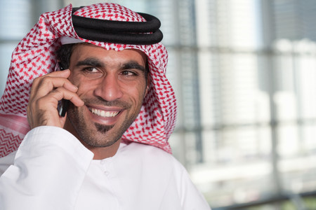 Middle eastern man on cellphone LANG_EVOIMAGES