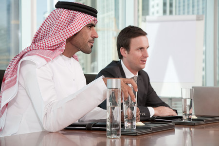Western and middle eastern businessmen in meeting LANG_EVOIMAGES
