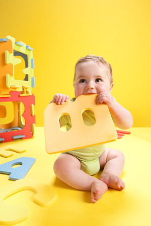 Baby boy playing with toy alphabet letters LANG_EVOIMAGES