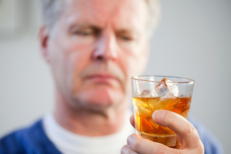 icecubes: Man with glass of whisky