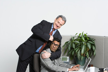 45 50 years: Businessman in headlock LANG_EVOIMAGES