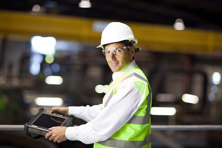 Engineer with handheld computer