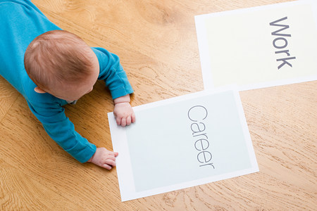 6 year old: Baby with papers saying work and career