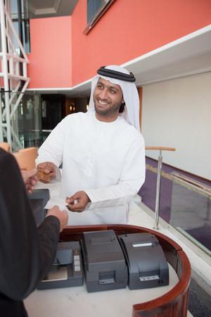 cash register building: Middle eastern businessman making transaction