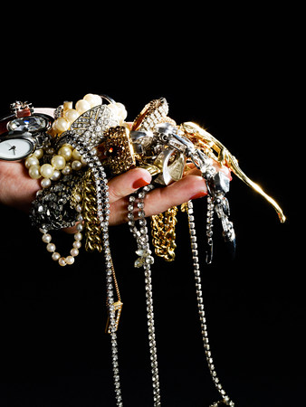 Woman holding jewelry LANG_EVOIMAGES