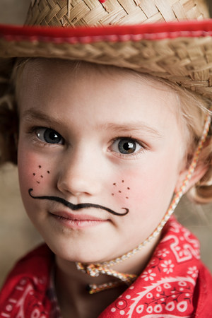 off shoulder: Young girl dressed up as cowgirl