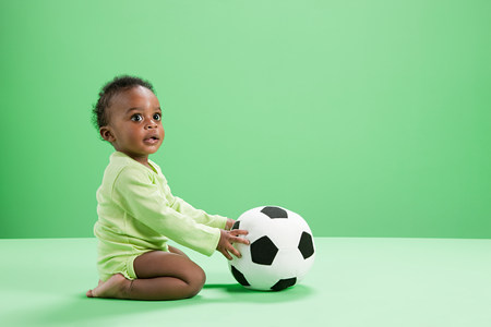 Baby boy playing with football LANG_EVOIMAGES