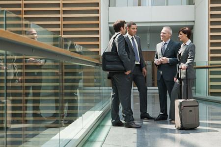 Businesspeople meeting on walkway