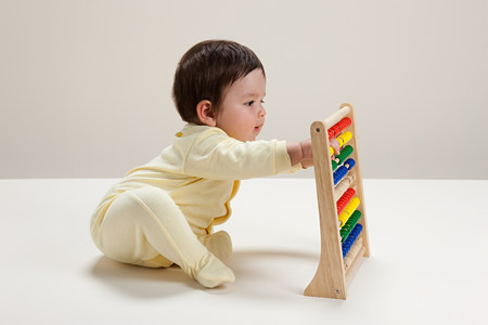 Baby boy playing with abacus