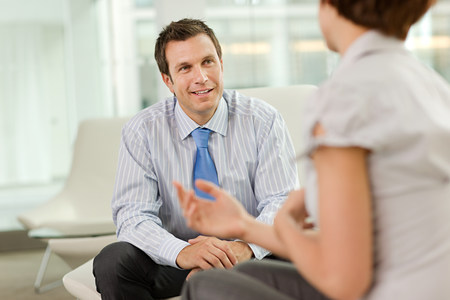 30 years old man: Businessman and businesswoman talking