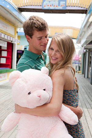 Teenage couple with teddy bear LANG_EVOIMAGES