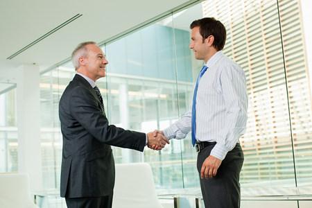 file clerk: Businessmen shaking hands