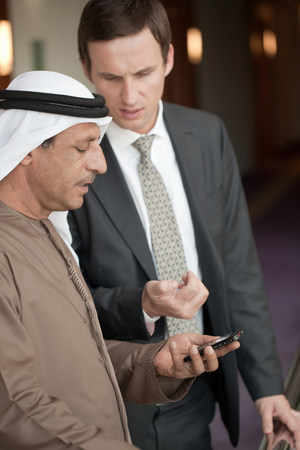indicate: Middle eastern and western businessmen LANG_EVOIMAGES