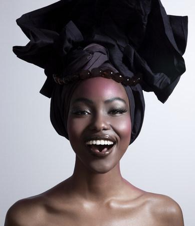 shadowed: Happy young woman wearing head tie
