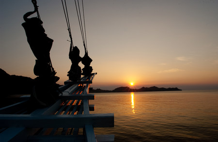 Sailing vessel at sunset.