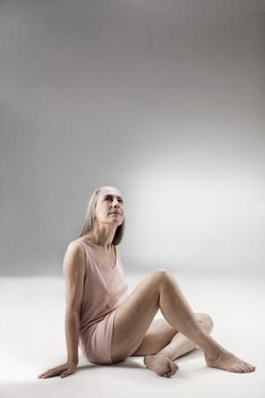 Senior woman sitting on floor LANG_EVOIMAGES