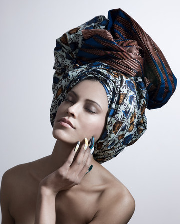 sultry: Young woman wearing head tie and artificial nails LANG_EVOIMAGES