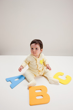 letter c: Baby boy playing with toy alphabet letters LANG_EVOIMAGES