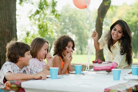 blacks: Children at birthday party with birthday cake