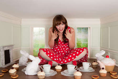 tea breaks: Young woman having tea party in small room