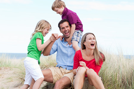 multi age: Family having fun at the coast