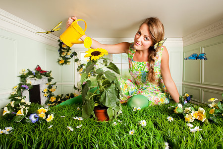Young woman with garden in small room LANG_EVOIMAGES