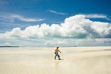 Man walking along beach