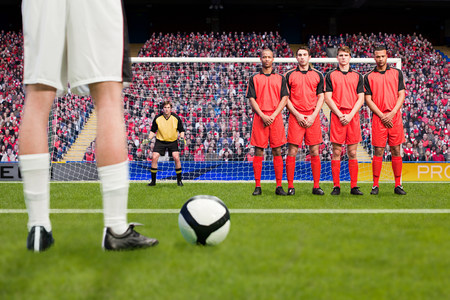 Free kick during a football match LANG_EVOIMAGES
