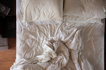 unmade: Overhead view of unmade bed