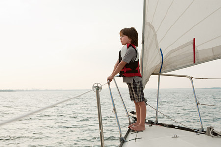 ponderous: Young boy on board yacht, looking at view LANG_EVOIMAGES