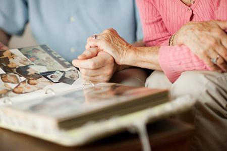 novel: Senior couple with at family album