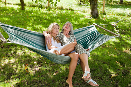 above 18: Mother and daughter relaxing in hammock LANG_EVOIMAGES