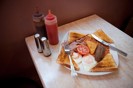 unhealthiness: English breakfast on a cafe table