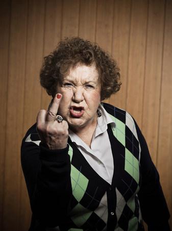 obscene: Senior woman making obscene gesture LANG_EVOIMAGES