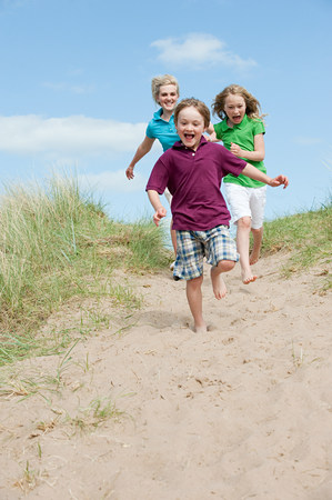 exhilarating: Brother and sisters running to the beach