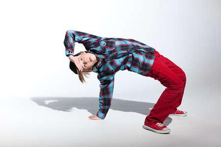 facing backwards: Teenage boy bending backwards LANG_EVOIMAGES