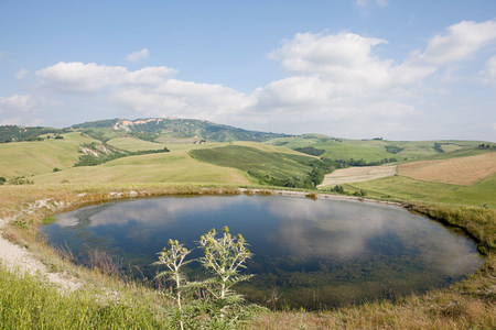 leisurely: Pond and fields near Volterra, Tuscany, Italy
