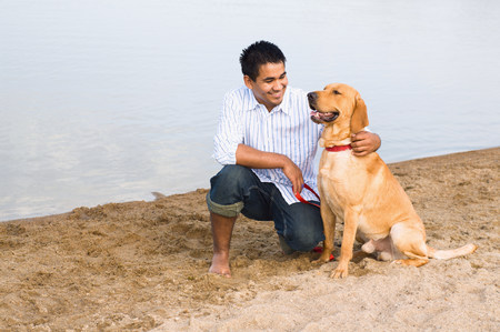 pooches: Man and golden retriever at the beach