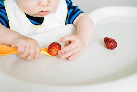 furniture part: Baby eating strawberries