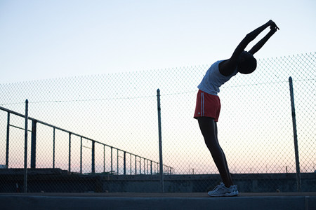 fenced in: Runner stretching