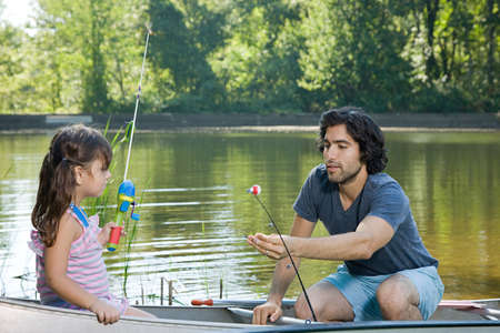 rowboats: Father and daughter on rowboat with fishing rods