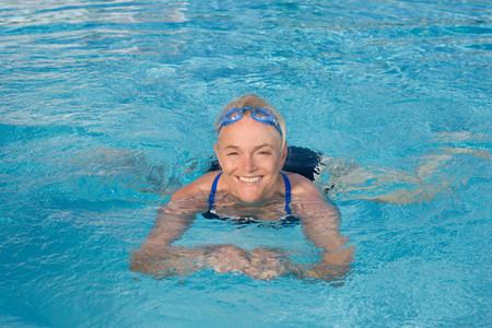 Mature woman swimming in pool