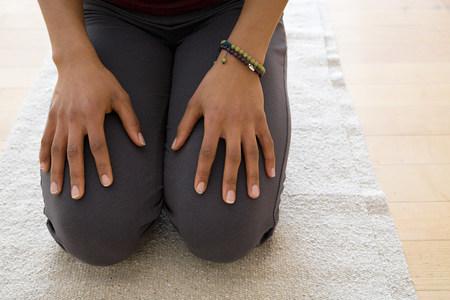 afro caribbean ethnicity: Woman kneeling