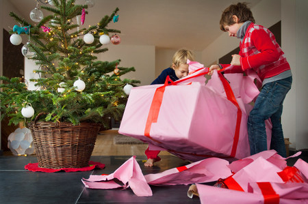 untidiness: Two boys unwrapping Christmas presents